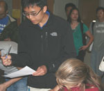Students sign up for various BSSA activities, including the mentor-mentee program prior to the meeting.