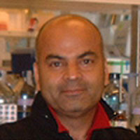 Headshot of Vivek Malhotra in the lab