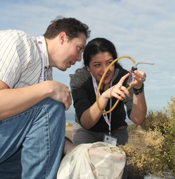 Two students examine a captured insect.