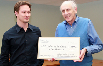 Valentino Gantz accepts the award from founding faculty member, Stu Brody